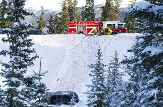 East Grand firefighters observe an SUV that rolled over a gaurdrail on Berthoud Pass near the parking lot for Second Creek around 10 a.m. on Friday, Dec. 27. No one was injured due to the accident and traffic continued to flow both directions.