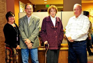 East Grand School District Superintendent Jody Mimmack, left, with retiring board members Tom Sifers, Barbara Ahrens and Jerry Reed prior to the school board meeting on Tuesday evening, Nov. 19, in Granby.