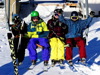 Mitch Cunico, from left to right, Andy Volt, Cody Volt and Sawyer Cousineau catch the first chair of the season at Ski Granby Ranch on Wednesday morning, Dec. 11, in Granby.