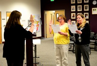 Robin Trainor, center, and Deb Shaw, right, are sworn in as Granby trustees by Granby town clerk Deb Hess during  Tuesday's, April 8, town board meeting at Granby Town Hall.