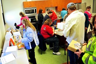 Pies are snatched up quickly at the start of the 11th Annual Thanksgiving Holiday Pie Sale on Tuesday morning, Nov. 26, at the Grand County Administration Building in Hot Sulphur Springs.  Proceeds from the sale go to the Hot Sulphur Springs Library and the Grand County Library District.
