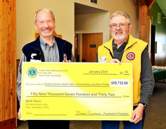 Fraser River Valley Lions Club president Jerry Nissen, left, and Lions Foundation of Fraser Valley president Dennis Troutman hold a check representing nearly $60,000 that the organization presented to 23 local nonprofit organizations during a luncheon on Thursday, Jan. 23, at Snow Mountain Ranch.  Recipients of the funds were: Fraser Valley Library, Grand County Historical Association, Rocky Mountain Repertory Theater Youth Theater Program, Eternal Hills Christian Preschool, Fraser Valley Elementary  2nd Grade Class, Fraser Valley Elementary Special Education, Indian Peaks Charter School, Advocates For A Violence Free Community, Girl Scouts, Grand Angels, Grand County Council on Aging, Grand County Rural Health Network, Grand Futures Prevention Coalition, Heart of the Mountains Hospice, Horizons Specialized Services, Mountain Family Center, Northwest Rocky Mountain CASA, Run For Independence, Shining Stars Foundation, Colorado Lions Camp, Colorado Lions Kidsight, Lions Club Foundation of Fraser Valley Inc., Local Vision Assistance, Rocky Mountain Lions Eye Bank, Rocky Mountain Lions Eye Institute Foundation, Middle Park Volleyball, National Sports Center For the Disabled and Winter Park Horseman's Association.