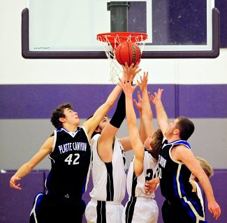 Middle Park's Jace Linke (32) and Tyler Wengert (20) battle for a rebound with Platte Canyon's Kenny Michel (42) and Hank Bode (20) during Tuesday's, Feb. 4, game in Granby.  The Panthers lost 53-45.