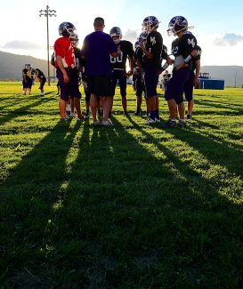 Middle Park football coach Adam Bright talks with the offense during practice on Wednesday evening, Sept. 3, in Granby. The Panthers host Estes Park tonight at 7 p.m.