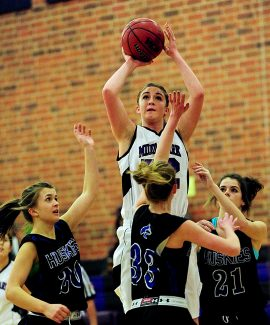 Middle Park's Erin O'Connor (52) shoots over Platte Canyon's Sammy Kirby (33) during Tuesday's, Feb. 4, game in Granby.  The Lady Panthers rolled over Platte Canyon 57-17.