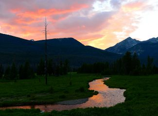 The sunset fills the sky with color over the Kawuneeche Valley on Sunday evening, July 13, in Rocky Mountain National Park.
