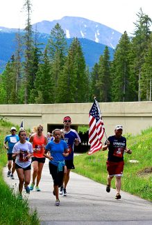 Participants in the 20th Annual Run for Independence run along the Fraser River Trail after passing under U.S. 40 on Saturday morning, July 5, in Winter Park.