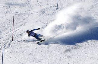 Cole Riccio of Middle Park High School falls while competing during the CHSAA slalom race at Winter Park Resort on Friday, Jan. 17.  Cody Charland was the top finisher for Middle Park, skiing to an ninth-place finish.