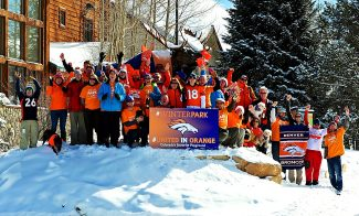 Winter Park community members gather in front of the Winter Park & Fraser Chamber of Commerce building to show their support of the Denver Broncos in the Super Bowl on Tuesday, Jan. 28, in Winter Park.