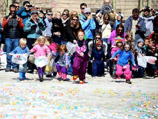 Children make a dash for Easter eggs at the start of the egg hunt at the base of Winter Park Resort on Sunday, April 20.