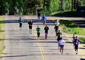 Participants in the Winter Park Half Marathon run along Forest Trail on Saturday morning, June 28, in Winter Park. The event was a fundraiser for the Shining Stars Foundation.