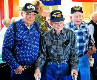 Grand County World War II veterans Lloyd Palmer, from left, George Mitchell and John Sheriff pose for a photo at the Grand County Veterans Day Breakfast on Monday morning, Nov. 11, at Snow Mountain Ranch.