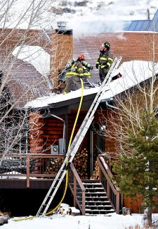 Granby firefighters work on a chimney fire at a residence at 111 Overlook Drive in Granby on Saturday, Dec. 28.