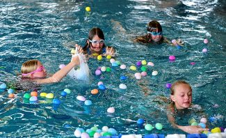 Children gather eggs in the swimming pool at the Grand Park Community Recreation Center during the Egg-quatic Egg Hunt on Friday morning, April 18, in Fraser.