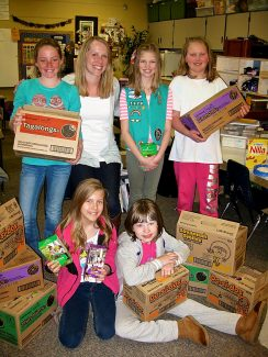 Junior Girl Scouts from troop #1429 donate 118 boxes of cookies to their Hometown Heroes, Heart of the Mountain Hospice, in honor of their friend and fellow girl scout, Traci Brammer, who recently lost her battle with cancer. Pictured, top row, left to right: Lane Bjerken, Brandee Piper (Heart of the Mountain Hospice representative), Emma Lane and Kate McCauley. In front Bianca Teter and Mia Rimmer. Not pictured: Angelina Butler.