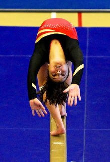 Katrina Quinn performs her balance beam routine during the gymnastics meet on Saturday morning, June 28, at the Grand Park Community Recreation Center in Fraser.