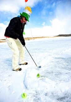 Susan Billington sinks her putt during the Ice Hole Tournament on Saturday, March 15, on Wolford Mountain Reservoir north of Kremmling.  The event was a fundraiser for the West Grand Booster Club.  See another photo on page 12.