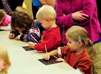 Children participate in a craft project during Children's Story Hour on Thursday, Nov. 7, at the Granby Library.