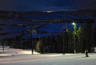 Skiers and snowboarders make their way down the Easy Money trail at Ski Granby Ranch on Saturday evening, March 29. Granby Ranch night skiing ended for the season.