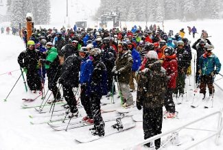Skiers and snowboarders queue up for the opening of the Super Gauge Express chairlift at the base of Mary Jane Thursday morning, Jan. 30, at Winter Park Resort to take advantage of the 11 inches of snow the ski area received.  More snow is forecast through Friday.