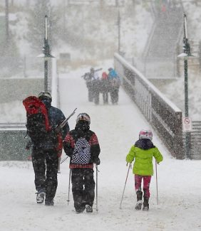 Skiers make their way back to their vehicles at the end of the afternoon at Winter Park Resort on Saturday, Nov. 16, as snow continues to fall.  Winter Park reported a total of 22 inches of snow from the weekend storm.