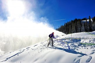 Winter Park Resort snowmaker Joe Stephen frees an air line from the snow on the Lower Parkway trail on Thursday morning, Nov. 7, at the ski area.  Winter Park opens for its 74th season on Wednesday, Nov. 13.