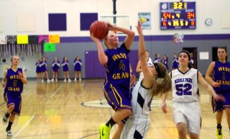 West Grand's Gabby Willson (4) trys for a jump shot during Tuesday night's game against the Middle Park Lady Panthers. The Middle Park Lady Panthers won the game 61-39.