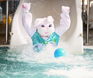 The Easter Bunny takes a ride down the water slide at the Grand Park Community Recreation Center on Friday, April 18, in Fraser.