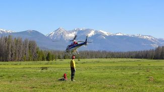 "A ""Type 2"" Helicopter lifting off from the Big Meadows Fire Helibase.  NPS Photo"