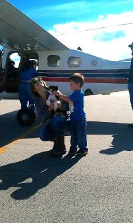 Shea Murphy and her 4 year-old son Tucker, recieve Jed, a 11-week old rescue puppy, after the puppy was transported to Granby from Utah by a pilot involved in the Pilots N' Paws program after being adopted by Murphy.
