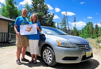 "Randall Barrett, left, and his wife, Toni, pose with the car he won on ""The Price is Right"" game show on April 29. Byron Hetzler/Sky-Hi News"