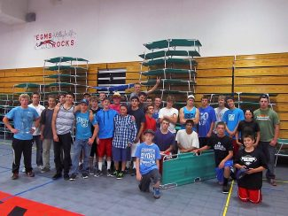 Members of the Middle Park football team assisted the American Red Cross with setting up cots in the East Grand Middle School gym on Friday evening, Sept. 13, in Granby. The school sheltered more than 170 students, teachers and chaperones from the Lucile Erwin Middle School in Longmont on Friday evening who had been staying at the YMCA of the Rockies in Estes Park.