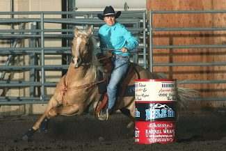 Lisa Mirabito and her horse Stewart round a barrel during the 2012 D.R. Horton finals in Loveland.