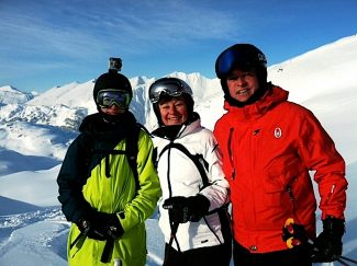 Peggy Smith, center, and her son Connor Nelson, left, and her husband Peter Nelson stop to take a photo during a recent heli-skiing trip to Alaska. Smith has been named the recipient of the 2014 Service Above Self award by the Winter Park-Fraser Valley Rotary Club.
