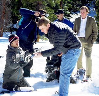 Colorado U.S. Sen. Michael Bennet measures the water content of the snowpack on Berthoud Pass with the help of William Shoup a state soil scientist for Colorado.