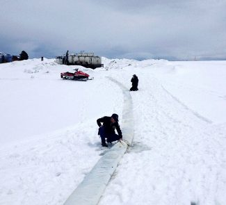 Heavy spring snows made stocking fish a challenge recently at Lake Granby. Wildlife officials had to lengthen the hatchery truck's hose to 200 feet by adding another hose so it could reach the lake.