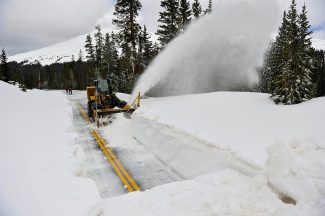 Arnie Johnson clears snow from Trail Ridge Road between Milner Pass and Medicine Bow Curve in Rocky Mountain National Park on Tuesday, May 21.  Park officials hope to have the road completely open on Friday for Memorial Day weekend, but still have a significant amount of clearing to do.  Trail Ridge Road is currently open to Milner Pass on the west side of the park.  Byron Hetzler/Sky-Hi News