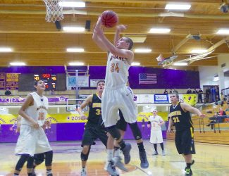 West Grand's Leo Pesch (24)has his shot blocked by a Meeker player during the Friday, Jan. 17, game in Kremmling. The Mustangs lost  63-57.