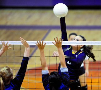 West Grand's Peyton Bodemann hits past the North Park block during Wednesday's, Sept. 11, match in Kremmling.  West Grand won the match in three-straight sets, 25-14, 25-22, 25-14.  The Lady Mustangs host Hotchkiss on Saturday at 3 p.m. in Kremmling.