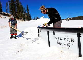 Erik Becker, left, and Euel Chaote put the finishing touches on a terrain park feature in Sorensen Park at Winter Park Resort on Tuesday, Nov. 12.  The resort opens for its 74th season today.