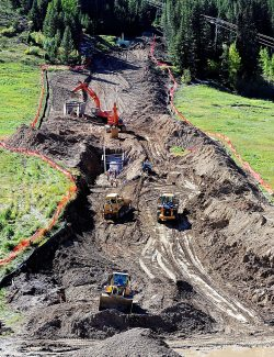Work continues to bury the Denver Water Board pipe at the base of Winter Park Resort on Wednesday afternoon, Sept. 25.