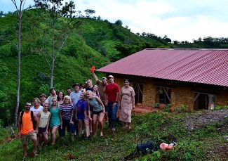 A group of local Young Life participants pose in front of the community and public health building they helped to construct in a remote village in the moutains of Hoduras this past July.