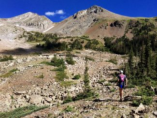 Andrew Wise, 21, of Grand Lake prepares to navigate the boulder field below Lake of the Clouds in the Never Summer Range on July 20, 2016.