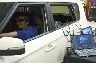 """High school freshman Anael Castillo takes the UNITE impaired driving simulator for a spin on Nov. 25 at West Grand High School. Although she's only 15, Castillo has experience driving and found maneuvering the simulator a challenge. """"It was hard,"""" she said. """"If you were to turn, it was overexaggerated."""""""