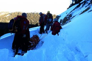 Grand County Search and Rescue personnel carry out a Tabernash skier who was injured on Berthoud Pass.