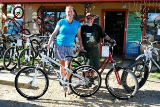 Sue and V.J. Valente of Full Circle Cyclery in Granby pose with the bicycles that the winner of their essay contest can choose between.  Byron Hetzler/Sky-Hi News