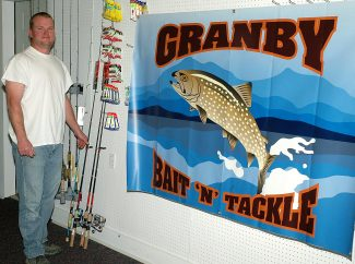 Mike Ivy, owns and operates the new Granby Bait and Tackle store, in Granby, with wife Kim.
