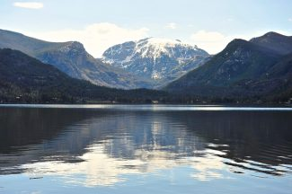 Mount Baldy is reflected in Grand Lake on a recent morning.  Byron Hetzler/Sky-Hi News