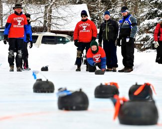 The Trophy Husbands (in red) compete against the Bayou City Bowlers during a round of the teapot curling at the Grand Lake Winter Carnival on Saturday, Feb. 1.  The Trophy Husbands went on to take first place for the second year in a row.
