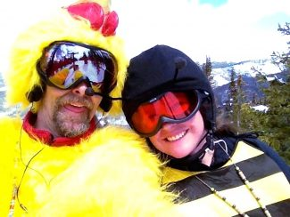 The chicken suit on the chairlift is Andy Peterson (Rocky Mountain Thunder Chicken) and his wife, Elizabeth Kurtak (Humble Bee), doing some spring skiing at The Jane on the last day of the season.